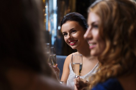 night out: celebration, friends, bachelorette party and holidays concept - happy women with champagne glasses at night club