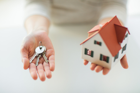 building estate: building, mortgage, real estate and property concept - close up of hands holding house model and home keys