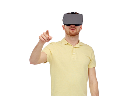 entertainment concept: 3d technology, virtual reality, entertainment and people concept - young man with virtual reality headset or 3d glasses playing game