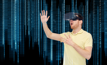mediated: 3d technology, virtual reality, entertainment and people concept - amazed young man with virtual reality headset or 3d glasses playing game over binary code background