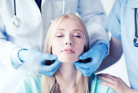 plastic surgeon: plastic surgeon or doctor with patient