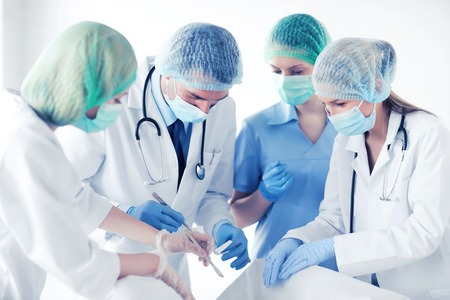 young group of doctors doing operation Stock Photo