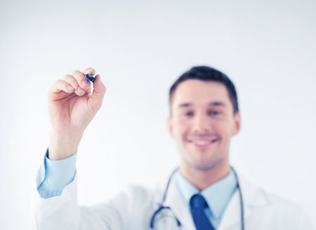 doctor writing: doctor writing something in the air with marker