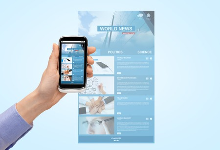 web screen: close up of woman hand with smartphone with news web page on screen Stock Photo