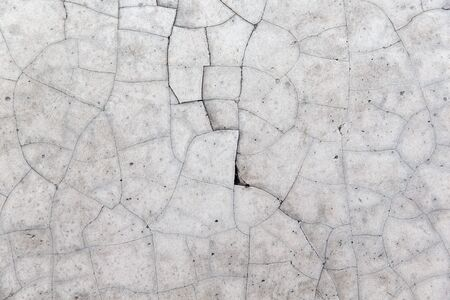 cracked: cracked gray concrete wall Stock Photo