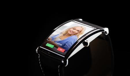 incoming: close up of black smart watch with incoming call