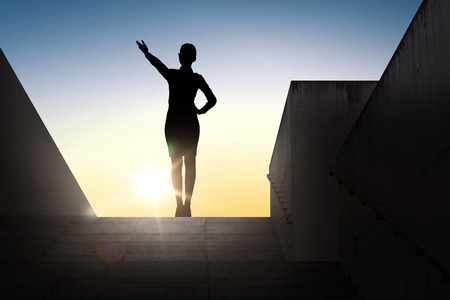 woman pointing: business, success, achievement and people concept - silhouette of woman pointing hand and showing direction standing on stairs over sun light background