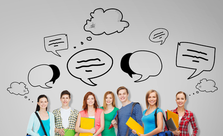 talk bubble: education, school and people concept - group of smiling teenage students with folders and school bags over gray background with text bubbles