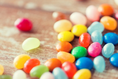 sweetstuff: food, junk-food, confectionery and unhealthy eating concept - close up of multicolored jelly beans candies on table
