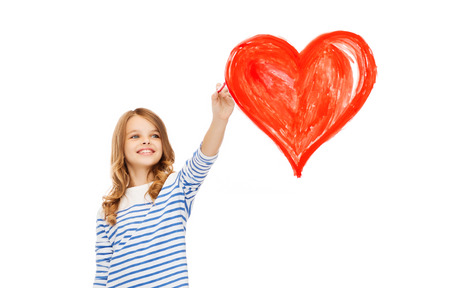 education, school and art concept - cute little girl drawing big red heart in the air