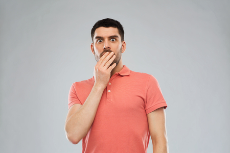 wtf: emotion, advertisement and people concept - scared man in polo t-shirt over gray background