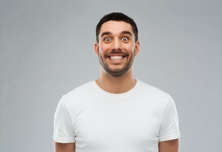 expression and people concept - man with funny face over gray background Imagens - 61556271