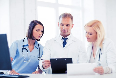 prescribing: healthcare and medical concept - team or group of doctors on meeting