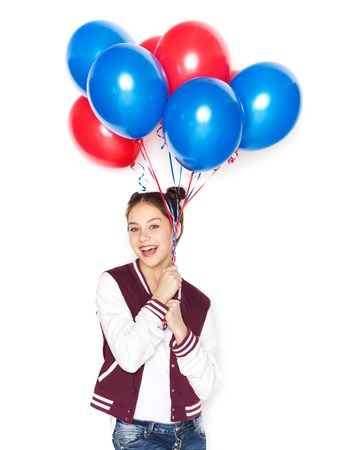 helium balloon: people, teens, holidays and party concept - happy smiling pretty teenage girl with helium balloons
