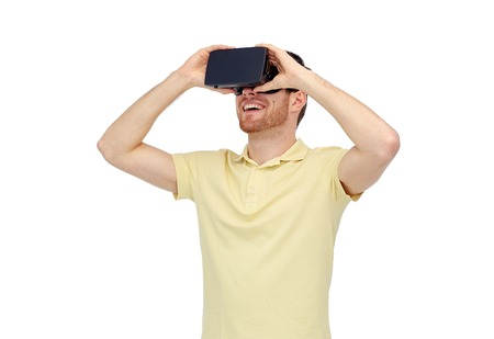 entertainment concept: 3d technology, virtual reality, entertainment and people concept - happy young man with virtual reality headset or 3d glasses