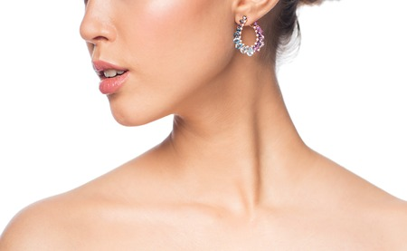 glamour luxury: glamour, beauty, jewelry and luxury concept - close up of beautiful woman face with earring