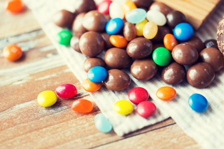 sweetstuff: food, junk-food, culinary, baking and eating concept - close up of jelly beans and chocolate candies on table Stock Photo