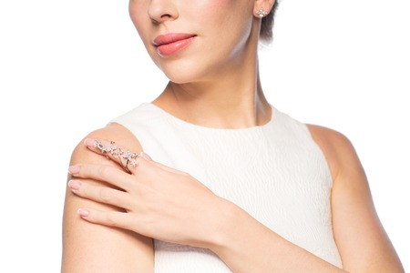 diamond ring: glamour, beauty, jewelry and luxury concept - close up of beautiful woman with golden ring and diamond earring Stock Photo