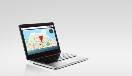 technology, navigation, location and advertisement concept - laptop computer with gps navigator map on screen Stock Photo