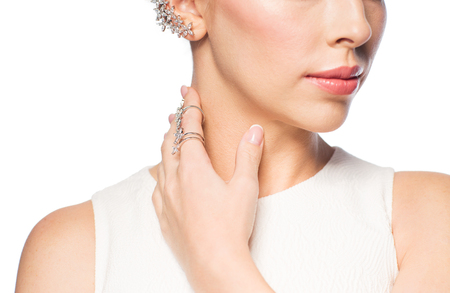 glamour luxury: glamour, beauty, jewelry and luxury concept - close up of beautiful woman with golden ring and diamond earring Stock Photo
