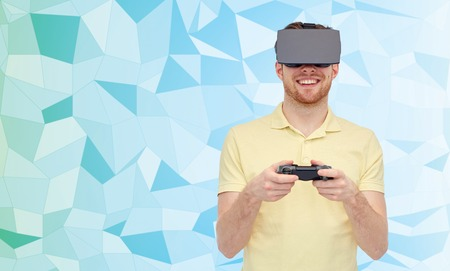 mediated: 3d technology, virtual reality, entertainment and people concept - happy young man with virtual reality headset or 3d glasses playing with game controller gamepad over low poly background