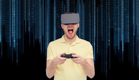 mediated: 3d technology, virtual reality, entertainment and people concept - young man with virtual reality headset or 3d glasses playing with game controller gamepad and screaming over binary code background