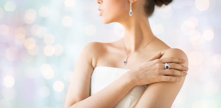 glamour luxury: glamour, beauty, jewelry and luxury concept - close up of beautiful woman with finger ring over holidays lights background Stock Photo