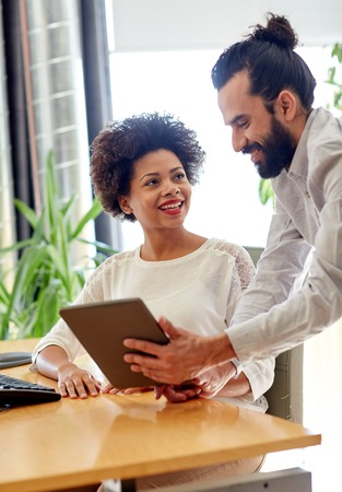 black couple: business, technology, startup and people concept - happy creative team with tablet pc computers in office