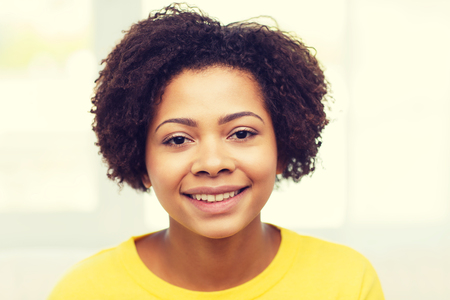 ethnicity: people, race, ethnicity and portrait concept - happy african american young woman face
