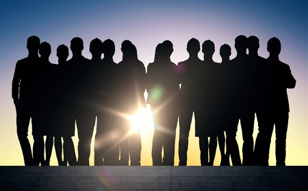 teamwork people: business, teamwork and people concept - business people silhouettes on stairs over sun light background