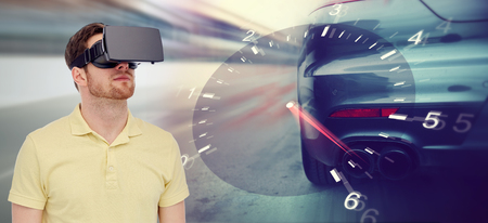mediated: 3d technology, virtual reality, entertainment and people concept - young man with virtual reality headset or 3d glasses playing car racing game over tachometer and street race background Stock Photo
