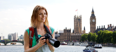 big ben tower: travel, tourism and people concept - happy young woman with backpack and camera photographing over london city street and big ben tower background