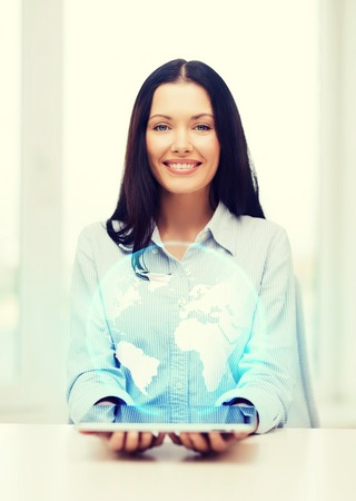internet globe: business, new technology and internet concept - smiling businesswoman with tablet pc computer and globe hologram
