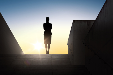 woman alone: business, success, achievement and people concept - silhouette of woman standing on stairs over sun light background
