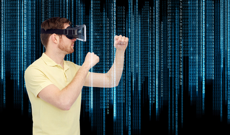 mediated: 3d technology, virtual reality, entertainment and people concept - young man with virtual reality headset or 3d glasses playing game and fighting over binary code background
