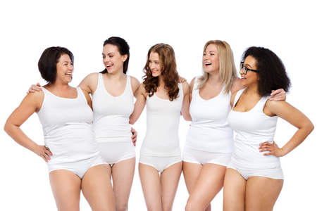 slim women: friendship, beauty, body positive and people concept - group of happy women different in white underwear