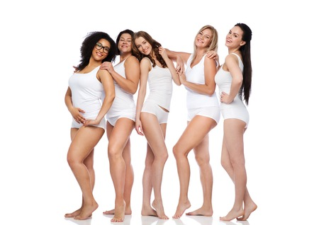 size: friendship, beauty, body positive and people concept - group of happy women different in white underwear