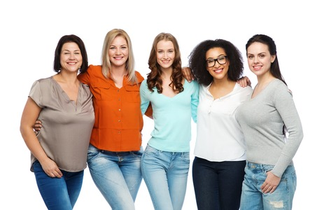 friendship, fashion, body positive, diverse and people concept - group of happy different size women in casual clothes Foto de archivo