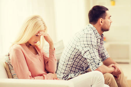 relationship difficulties: people, relationship difficulties, conflict and family concept - unhappy couple having argument at home Stock Photo