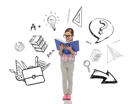 childhood, school, education and people concept - happy little girl in eyeglasses reading book with doodles Stock Photo