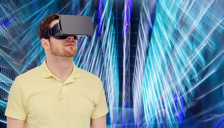 entertainment background: 3d technology, virtual reality, entertainment and people concept - young man with virtual reality headset or 3d glasses over spiral neon lights background Stock Photo