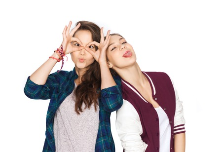 people, friends, teens and friendship concept - happy smiling pretty teenage girls having fun and making faces Stockfoto