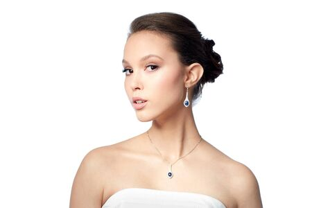 young asian: beauty, jewelry, wedding accessories, people and luxury concept - beautiful asian woman or bride with earring and pendant