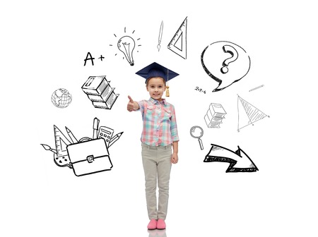 pre approval: childhood, school, education, learning and people concept - happy girl with in bachelor hat or mortarboard showing thumbs up with doodles