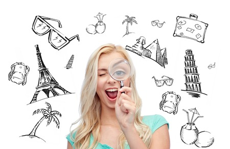 summer holidays: people, tourism, vacation and summer holidays concept - happy smiling young woman or teenage girl looking through magnifying glass over touristic doodles