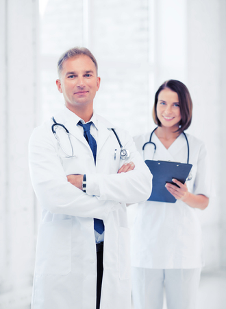 physiotherapists: healthcare and medical concept - two doctors in hospital Stock Photo