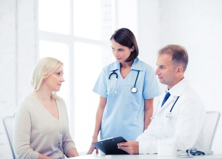 prescribing: healthcare and medical concept - doctor and nurse with patient in hospital