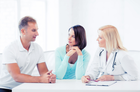 patients: healthcare and medical concept - doctor with patients in cabinet