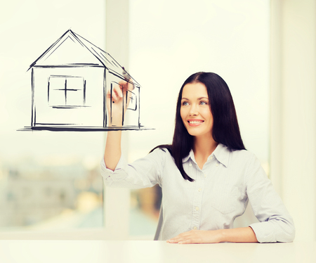 accomodation: real estate, accomodation and technology concept - smiling woman drawing house on virtual screen