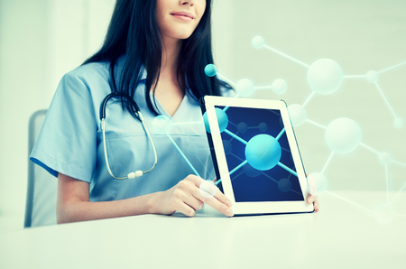 medicine, health and hospital concept - close up of female doctor showing molecular structure on tablet pc computer screen Stock Photo